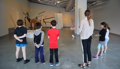 Illinois Art Station children and youth observing art